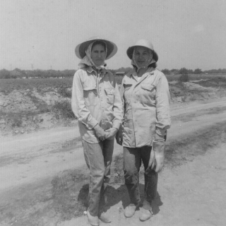 Amelia G. Barrera & Maria B. Garza dressed for  tomato harvesting in Vernalis CA 1965.