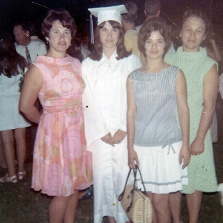 Yolanda Barrera in cap and gown with cousin, Ofelia, aunts Maria B. Garza and Lupe Farias from Mission Texas.